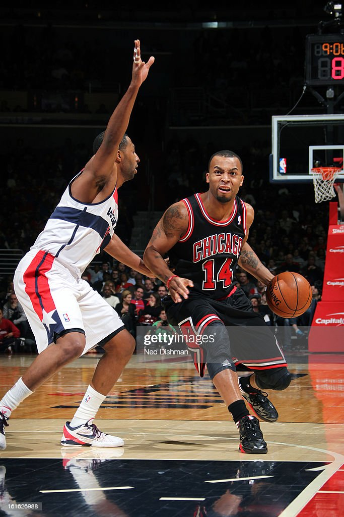 <a gi-track='captionPersonalityLinkClicked' href=/galleries/search?phrase=Daequan+Cook&family=editorial&specificpeople=3847493 ng-click='$event.stopPropagation()'>Daequan Cook</a> #14 of the Chicago Bulls drives to the basket against the Washington Wizards at the Verizon Center on January 26, 2013 in Washington, DC.