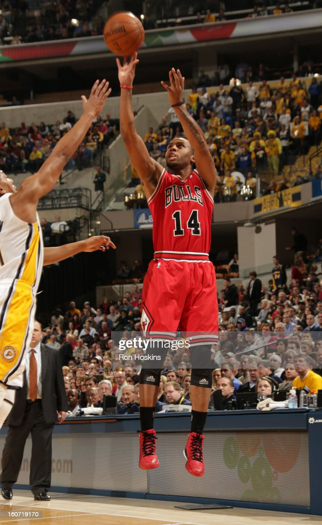 Daequan Cook #14 of the Chicago Bulls goes for a jump shot during the game between the Indiana Pacers and the Chicago Bulls on February 4, 2013 at Bankers Life Fieldhouse in Indianapolis, Indiana.