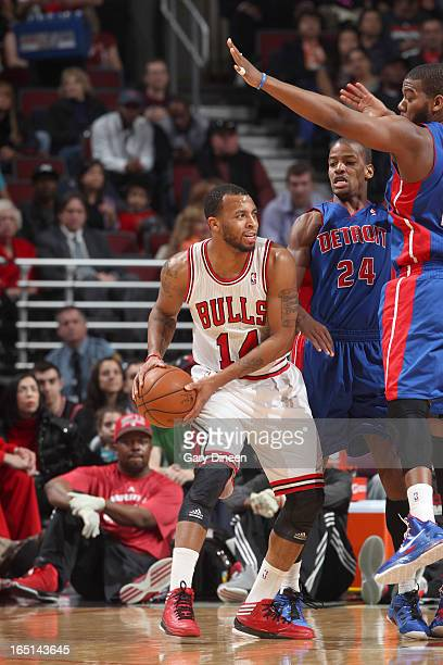 Daequan Cook of the Chicago Bulls looks to pass while guarded by Kim English and Greg Monroe of the Detroit Pistons on March 31 2013 at the United...