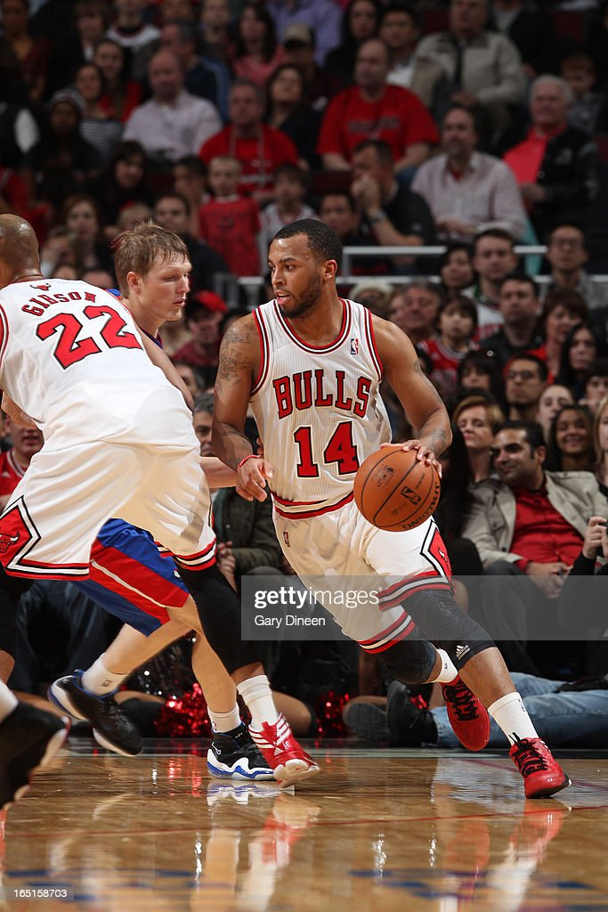 <a gi-track='captionPersonalityLinkClicked' href=/galleries/search?phrase=Daequan+Cook&family=editorial&specificpeople=3847493 ng-click='$event.stopPropagation()'>Daequan Cook</a> #14 of the Chicago Bulls moves the ball past <a gi-track='captionPersonalityLinkClicked' href=/galleries/search?phrase=Kyle+Singler&family=editorial&specificpeople=4216029 ng-click='$event.stopPropagation()'>Kyle Singler</a> #25 of the Detroit Pistons on March 31, 2013 at the United Center in Chicago, Illinois.
