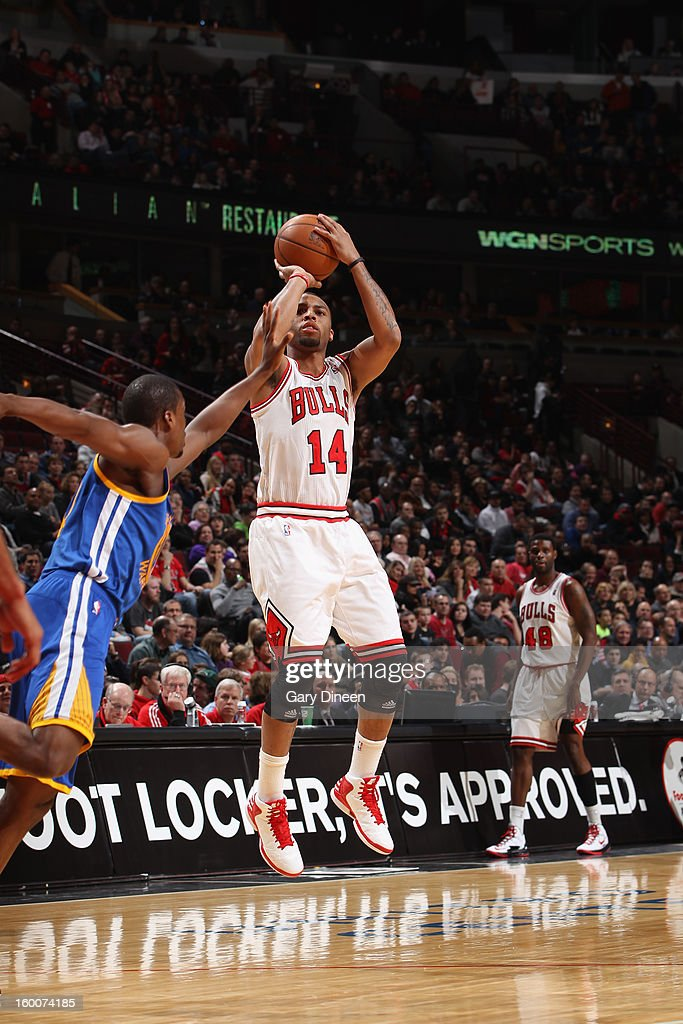 <a gi-track='captionPersonalityLinkClicked' href=/galleries/search?phrase=Daequan+Cook&family=editorial&specificpeople=3847493 ng-click='$event.stopPropagation()'>Daequan Cook</a> #14 of the Chicago Bulls shoots against Charles Jenkins #22 of the Golden State Warriors on January 25, 2012 at the United Center in Chicago, Illinois.