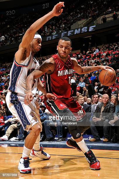Daequan Cook of the Miami Heat drives against Courtney Lee of the New Jersey Nets during the game on February 17 2010 at the Izod Center in East...