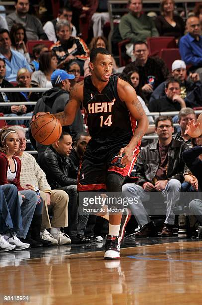Daequan Cook of the Miami Heat moves the ball against the Orlando Magic during the game on February 28 2010 at Amway Arena in Orlando Florida The...