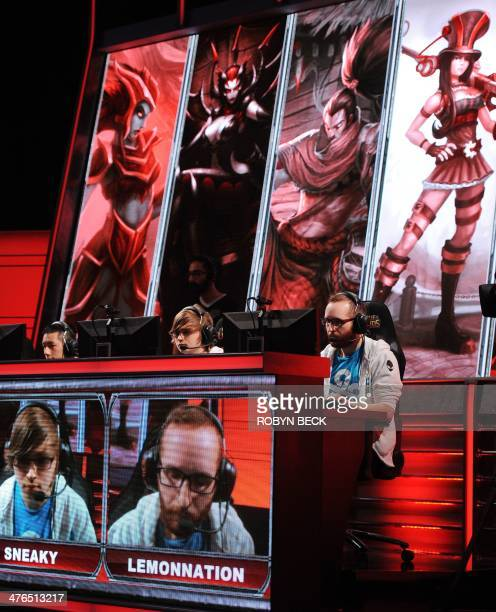 Daerek 'LemonNation' Hart and teammate Zachary 'Sneaky' Scuderi of team Cloud 9 follow the action during the live taping of the League of Legends...