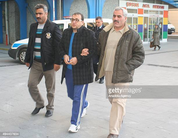 Daesh suspect among 30 others is seen as being detained during an antiterror operation targeting Daesh in Konya Turkey on October 27 2015