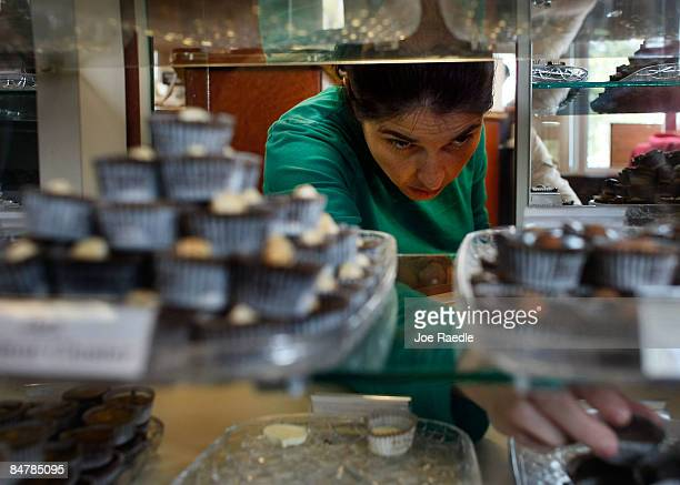Dafne Reich takes chocolates from a display to be put into a Valentine's Day chocolate gift pack at Schakolad Chocolate Factory on February 13 2009...