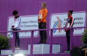 Dafne Schipper of Netherlands receives here Gold medal for the Women's 100m during day two of The European Athletics U23 Championships 2013 on July...