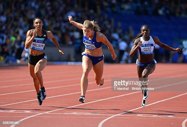 Dafne Schippers of Netherlands runs in the Final of the Women's 100m flanked by Ashleigh Nelson and Dina AsherSmith of Great Britain during the...