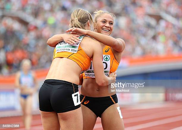 Dafne Schippers of The Netherlands and team mate Naomi Sedney celebrate after winning gold in the final of the womens 4x100m relay on day five of The...