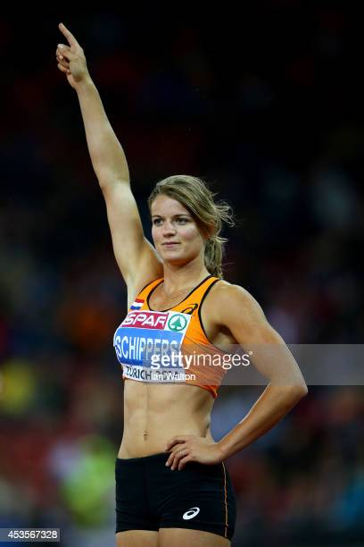 Dafne Schippers of the Netherlands celebrates claiming gold in the Women's 100 metres final during day two of the 22nd European Athletics...