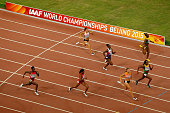 Dafne Schippers of the Netherlands crosses the finish line to win gold in the Women's 200 metres final ahead of second placed Elaine Thompson of...