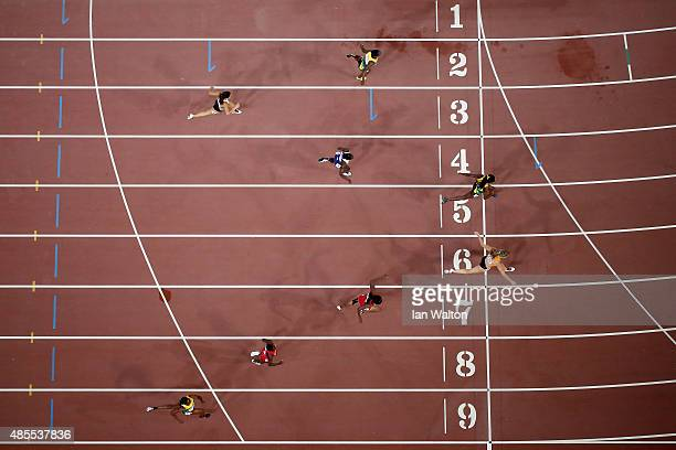 Dafne Schippers of the Netherlands crosses the finish to win gold in the Women's 200 metres final ahead of Elaine Thompson of Jamaica during day...