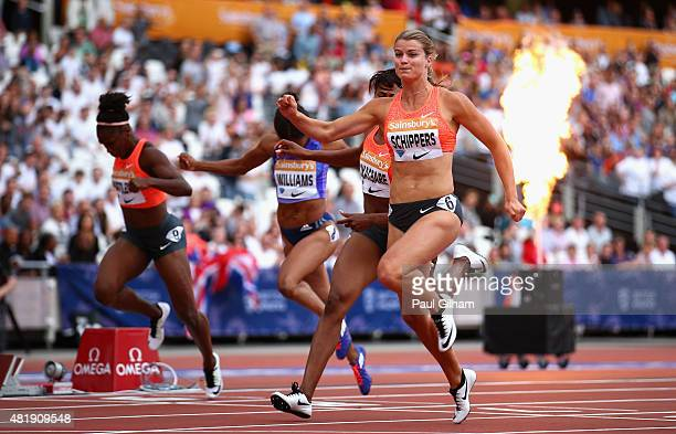 Dafne Schippers of the Netherlands crosses the line to win the Womens 100m Final during day two of the Sainsbury's Anniversary Games at The Stadium...