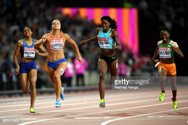 Dafne Schippers of the Netherlands MarieJosee Ta Lou of the Ivory Coast and Shaunae MillerUibo of the Bahamas cross the finish line in the Women's...