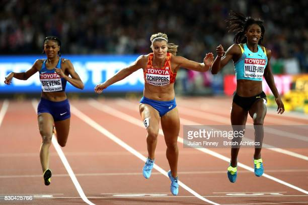 Dafne Schippers of the Netherlands Shaunae MillerUibo of the Bahamas and Deajah Stevens of the United States race to the finish line in the Women's...
