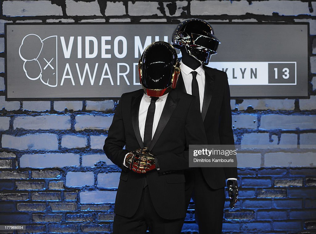 <a gi-track='captionPersonalityLinkClicked' href=/galleries/search?phrase=Daft+Punk&family=editorial&specificpeople=660593 ng-click='$event.stopPropagation()'>Daft Punk</a> attends the 2013 MTV Video Music Awards at the Barclays Center on August 25, 2013 in the Brooklyn borough of New York City.