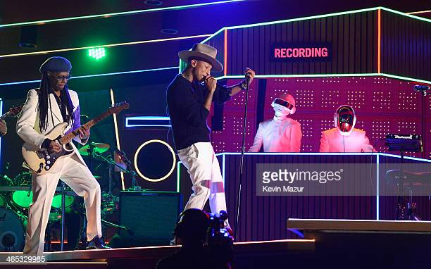 Daft Punk Nile Rogers and Pharrell Williams perform onstage during the 56th GRAMMY Awards at Staples Center on January 26 2014 in Los Angeles...