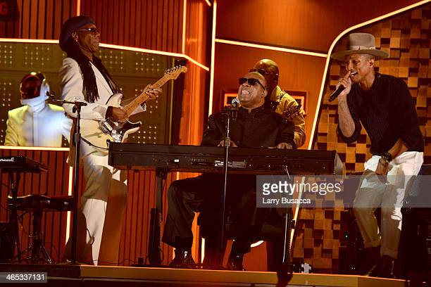Daft Punk's GuyManuel de HomemChristo musician Nile Rodgers and recording artists Pharrell Williams and Stevie Wonder perform onstage during the 56th...