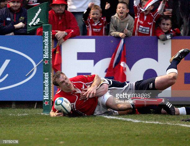 Dafydd James of Llanelli dives over to score the first try during the Heineken Cup quarter final match between Llanelli Scarlets and Munster at...