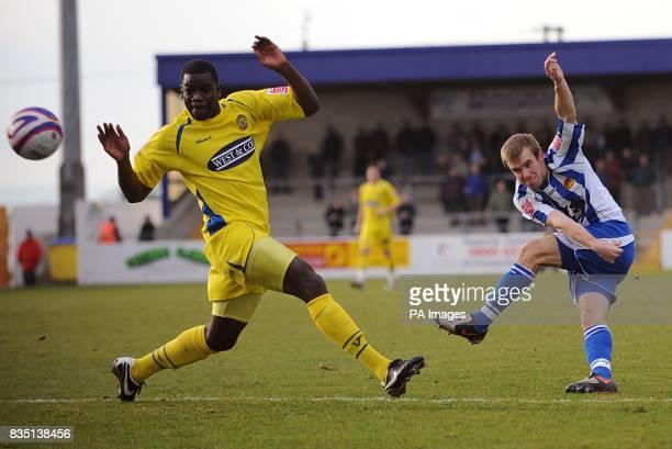 Dagenham Redbridge's Magnus Okuonghae fails to prevent Chester City's Laurence Wilson from taking a shot on goal This shot went wide