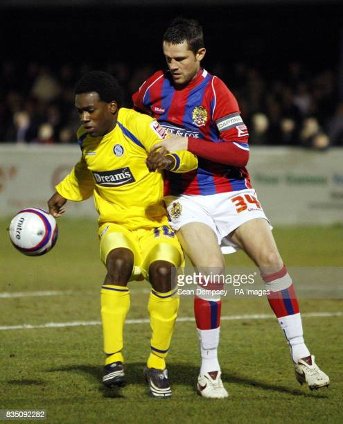 Dagenham Redbridge's Mark Arber and Wycombe Wanderes' JonPaul Pittman battle for the ball during the CocaCola League Two match at the LB Barking...