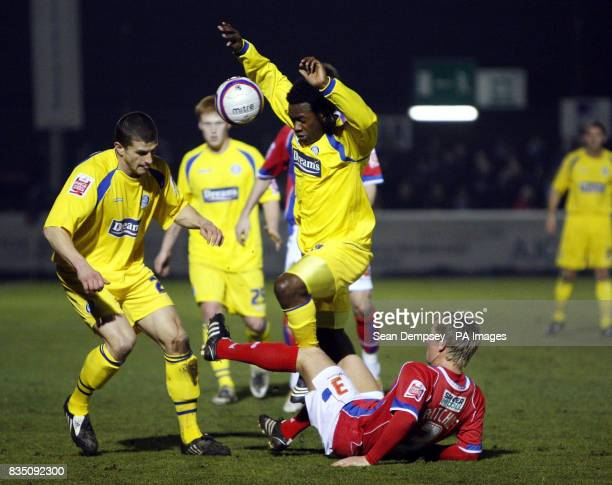 Dagenham Redbridge's Matt Ritchie and Wycombe Wanderes' JonPaul Pittman tangle as they battle for the ball during the CocaCola League Two match at...