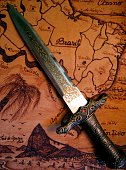 Dagger on leather map of Brazil.