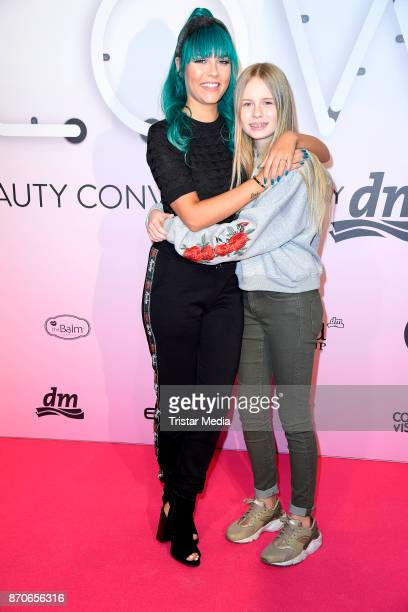 Dagi Bee and her sister Lena Ochmanczyk attend the GLOW The Beauty Convention at Station on November 4 2017 in Berlin Germany