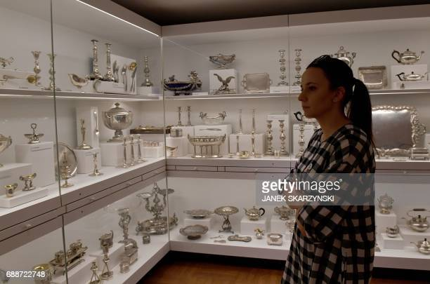 Dagmara Mazurek a press officer at the Museum of Warsaw which reopens after four years of renovation and redesign on May 26 looks at a silverware...