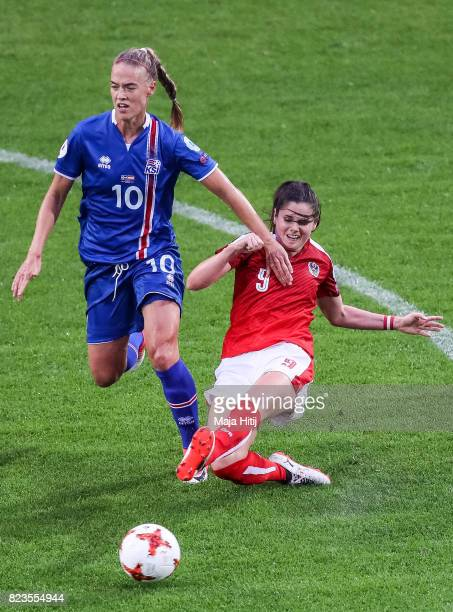 Dagny Brynjarsdottir of Iceland and Sarah Zadrazil of Austria battle for the ball during the Group C match between Iceland and Austria during the...