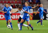 Dagny Brynjatsdottir of Iceland and Lena Lotzen of Germany battle for the ball during the UEFA Women's Euro 2013 group B match between Iceland and...