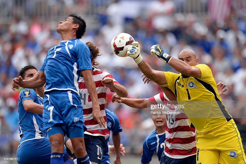 Dagoberto Portillo Gamero #1 of El Salvador makes a save on a corner kick by Jose Torres #16 of the United States in the first half of the 2013 CONCACAF Gold Cup quarterfinal game at M&T Bank Stadium on July 21, 2013 in Baltimore, Maryland.