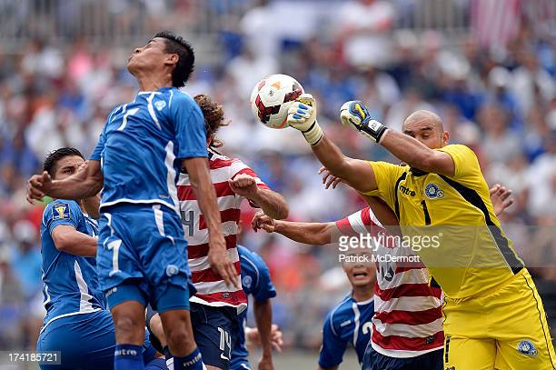 Dagoberto Portillo Gamero of El Salvador makes a save on a corner kick by Jose Torres of the United States in the first half of the 2013 CONCACAF...