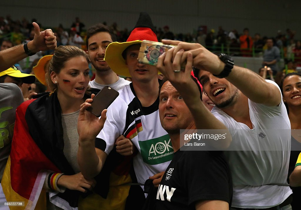 Dagur Sigurdsson of Germany celebrates their victory with fans following the Men's Bronze Medal Match between Poland and Germany on Day 16 of the Rio...