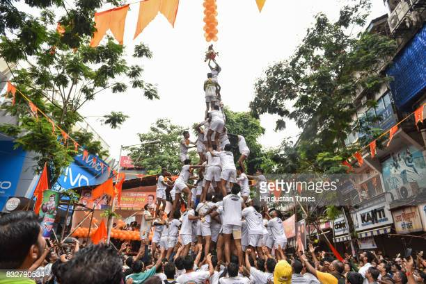 Dahi Handi celebrations at Dadar on August 15 2017 in Mumbai India The childgod Krishna and his friends used to form human pyramids to break pots...