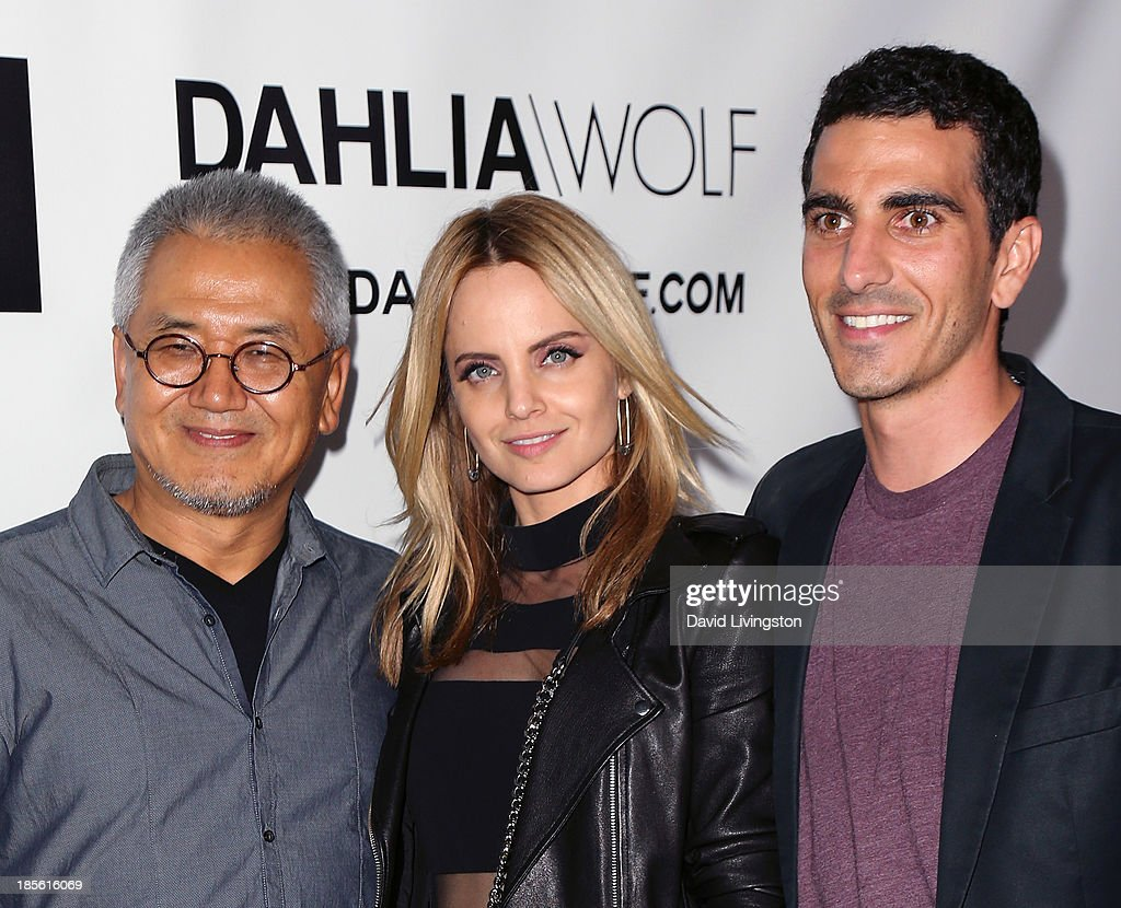 Dahlia Wolf co-founder Charles Park, actress Mena Suvari and Dahlia Wolf co-founder Justin Mavandi attend the Dahlia Wolf Launch Party at the Graffiti Cafe on October 22, 2013 in Los Angeles, California.