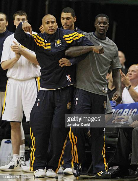 Dahntay Jones and Lance Stephenson of the Indiana Pacers lock arms as they watch their teammates take on the Miami Heat in Game Three of the Eastern...