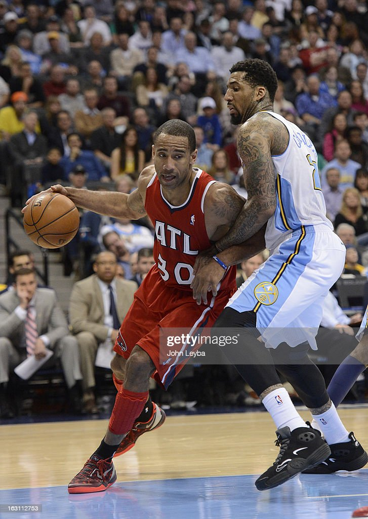 Dahntay Jones (30) of the Atlanta Hawks drives on Wilson Chandler (21) of the Denver Nuggets during the third quarter March 4, 2013 at Pepsi Center. The Denver Nuggets defeated the Atlanta Hawks 104-88.