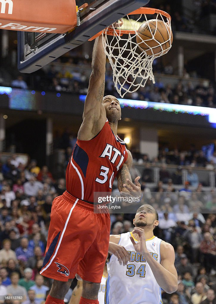 Dahntay Jones (30) of the Atlanta Hawks goes up for an easy dunk past JaVale McGee (34) of the Denver Nuggets during the third quarter March 4, 2013 at Pepsi Center. The Denver Nuggets defeated the Atlanta Hawks 104-88.