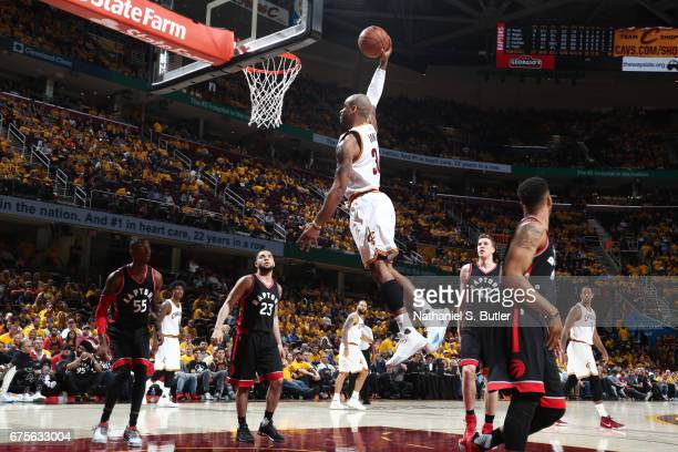 Dahntay Jones of the Cleveland Cavaliers dunks against the Toronto Raptors in Game One of the Eastern Conference Semifinals of the 2017 NBA Playoffs...