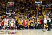 Dahntay Jones of the Cleveland Cavaliers shoots a three point shot over Tim Hardaway Jr #10 of the Atlanta Hawks to set a new NBA team record of 24...