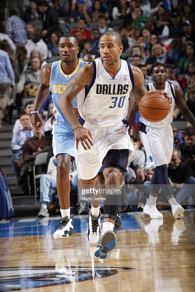 <a gi-track='captionPersonalityLinkClicked' href=/galleries/search?phrase=Dahntay+Jones&family=editorial&specificpeople=202206 ng-click='$event.stopPropagation()'>Dahntay Jones</a> #30 of the Dallas Mavericks brings the ball up court against the Denver Nuggets on December 28, 2012 at the American Airlines Center in Dallas, Texas.