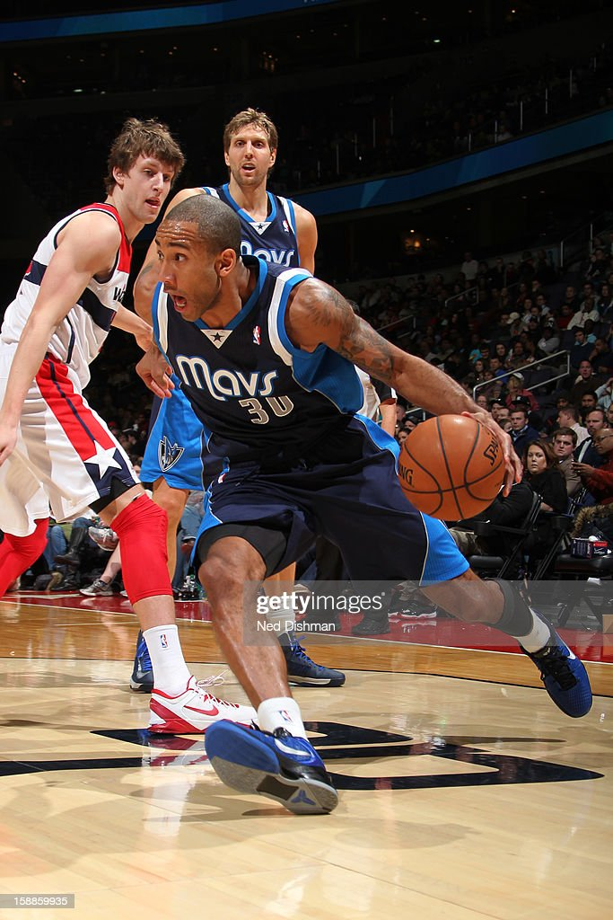 <a gi-track='captionPersonalityLinkClicked' href=/galleries/search?phrase=Dahntay+Jones&family=editorial&specificpeople=202206 ng-click='$event.stopPropagation()'>Dahntay Jones</a> #30 of the Dallas Mavericks drives against <a gi-track='captionPersonalityLinkClicked' href=/galleries/search?phrase=Jan+Vesely&family=editorial&specificpeople=5620499 ng-click='$event.stopPropagation()'>Jan Vesely</a> #24 of the Washington Wizards during the game at the Verizon Center on January 1, 2013 in Washington, DC.
