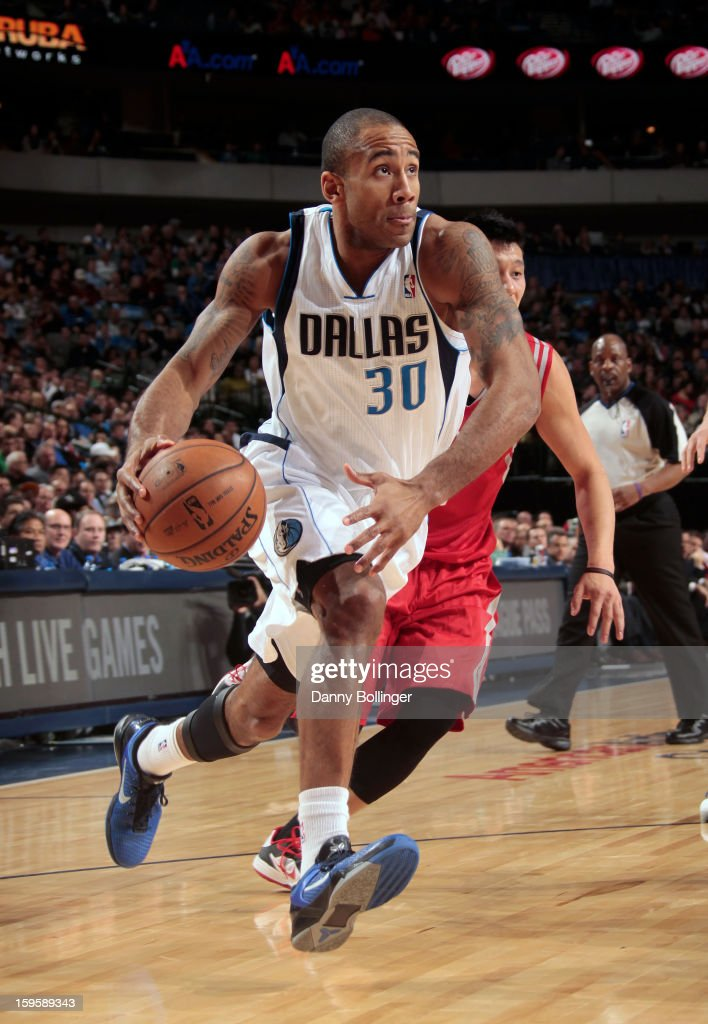 Dahntay Jones #30 of the Dallas Mavericks drives against the Houston Rockets on January 16, 2013 at the American Airlines Center in Dallas, Texas.