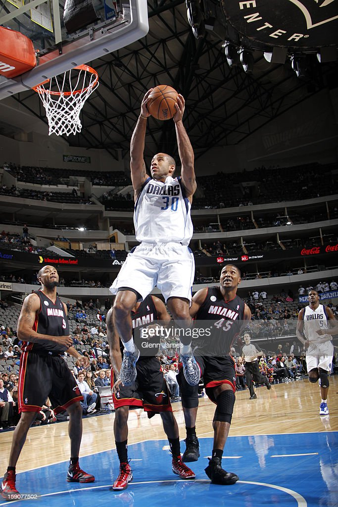 <a gi-track='captionPersonalityLinkClicked' href=/galleries/search?phrase=Dahntay+Jones&family=editorial&specificpeople=202206 ng-click='$event.stopPropagation()'>Dahntay Jones</a> #30 of the Dallas Mavericks drives to the basket against the Miami Heat on December 20, 2012 at the American Airlines Center in Dallas, Texas.