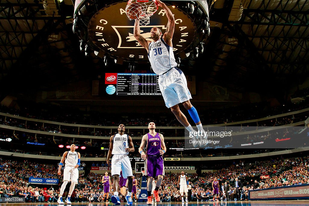 Dahntay Jones #30 of the Dallas Mavericks dunks against the Phoenix Suns on January 27, 2013 at the American Airlines Center in Dallas, Texas.