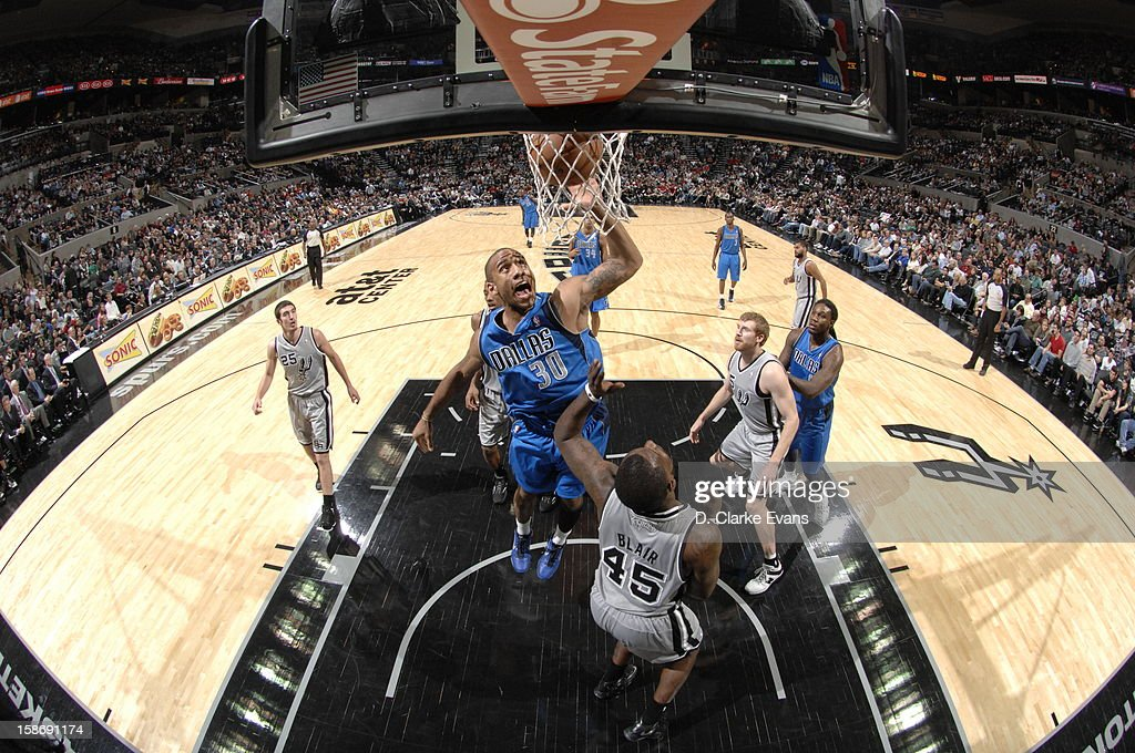 <a gi-track='captionPersonalityLinkClicked' href=/galleries/search?phrase=Dahntay+Jones&family=editorial&specificpeople=202206 ng-click='$event.stopPropagation()'>Dahntay Jones</a> #30 of the Dallas Mavericks goes to the basket during the game between the Dallas Mavericks and the San Antonio Spurs on December 23, 2012 at the AT&T Center in San Antonio, Texas.