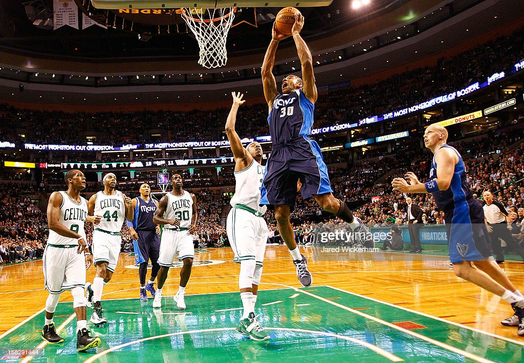 Dahntay Jones #30 of the Dallas Mavericks goes up to dunk the ball in front of Paul Pierce #34 of the Boston Celtics during the game on December 12, 2012 at TD Garden in Boston, Massachusetts.