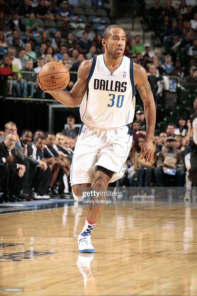 <a gi-track='captionPersonalityLinkClicked' href=/galleries/search?phrase=Dahntay+Jones&family=editorial&specificpeople=202206 ng-click='$event.stopPropagation()'>Dahntay Jones</a> #30 of the Dallas Mavericks handles the ball against the Minnesota Timberwolves on November 12, 2012 at the American Airlines Center in Dallas, Texas.