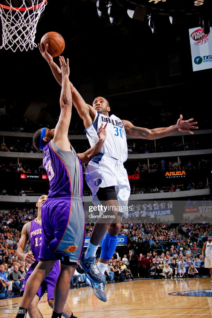Dahntay Jones #30 of the Dallas Mavericks shoots a layup against Jared Dudley #3 of the Phoenix Suns on January 27, 2013 at the American Airlines Center in Dallas, Texas.